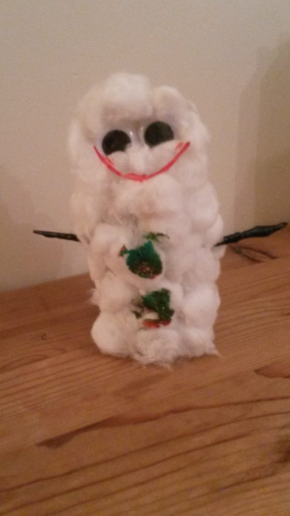 Snowman made with toilet roll tube covered in cotton wool with a slightly scary red mouth