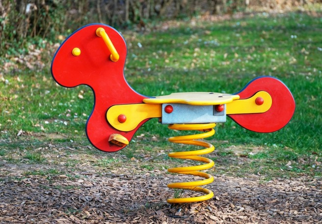 Bouncy, wooden, brightly coloured creature on springs
