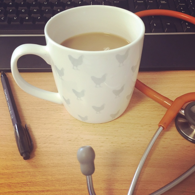 Coffee cup, stethoscope, keyboard, pen