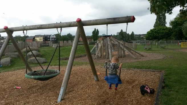 Boy still on swing facing the other way