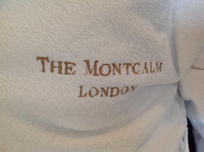 Logo of Montcalm on white dressing gown