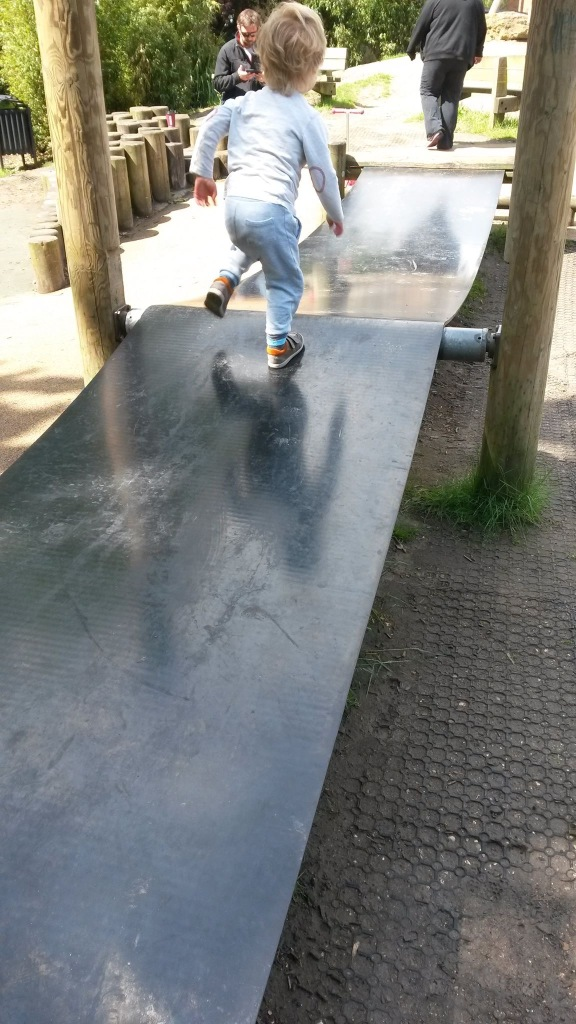 Son running along what looks like a conveyor belt. Big and bouncy