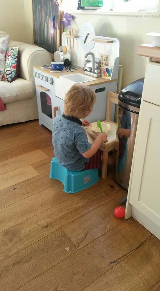 Boy eating next to the bin