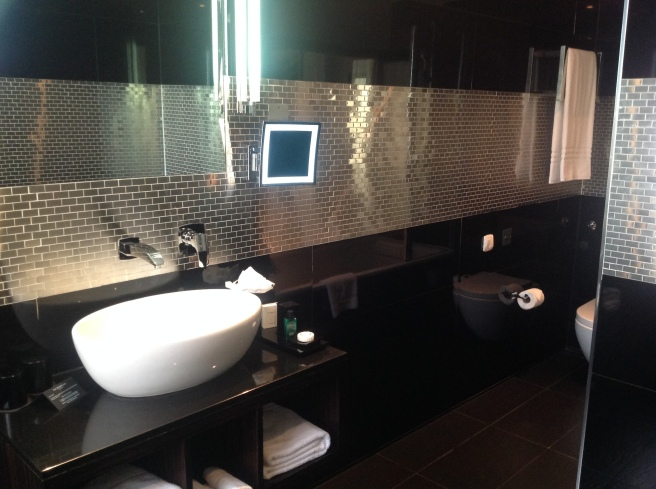 Silver and black tiles with sink in the ensuite