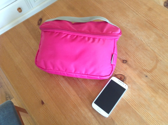 Small changing bag next to mobile phone