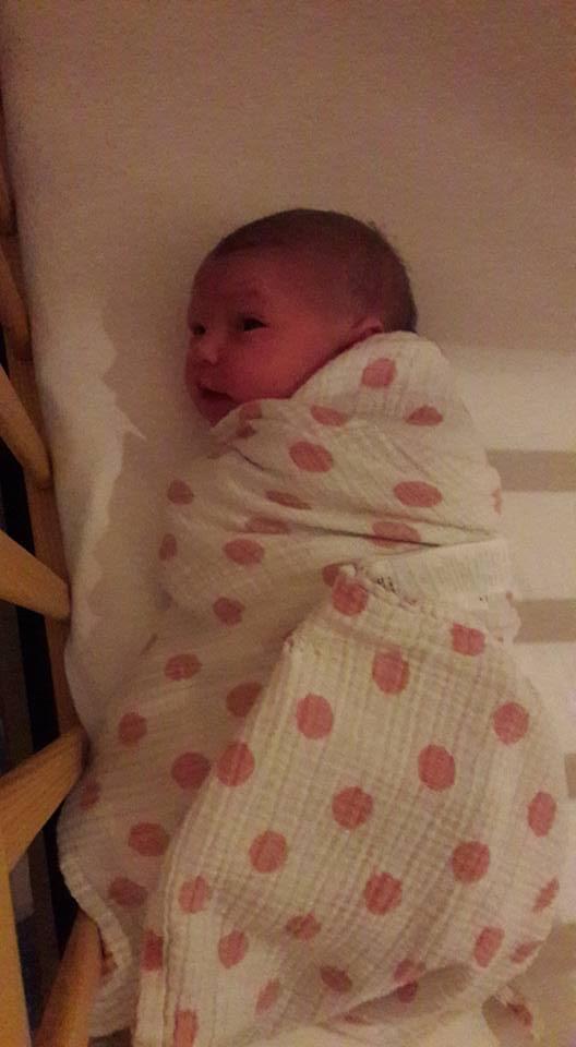 Newborn baby side view