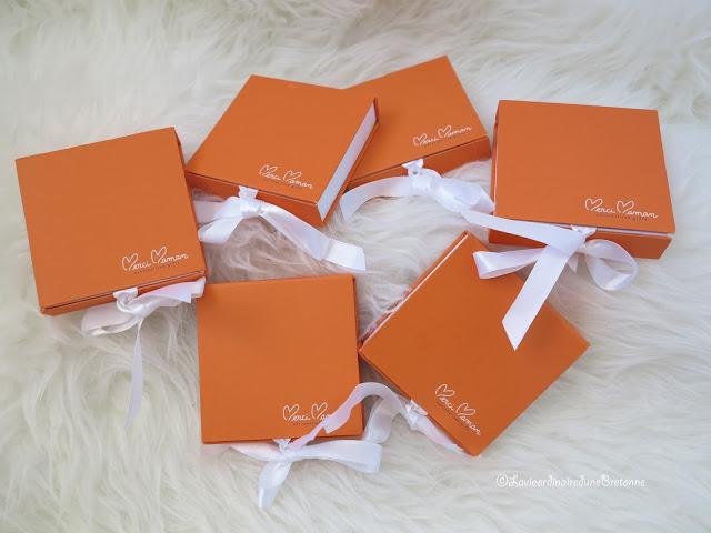 pile of orange merci maman boxes