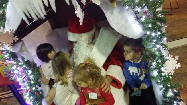 Father Christmas and lots of children