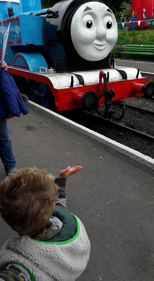 Small boy waving at Thomas the Tank Engine